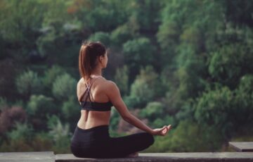 candid-authentic-millennial-athletic-girl-in-workout-sportswear-meditates-lotus-pose-outdoor-on_t20_no3VBg